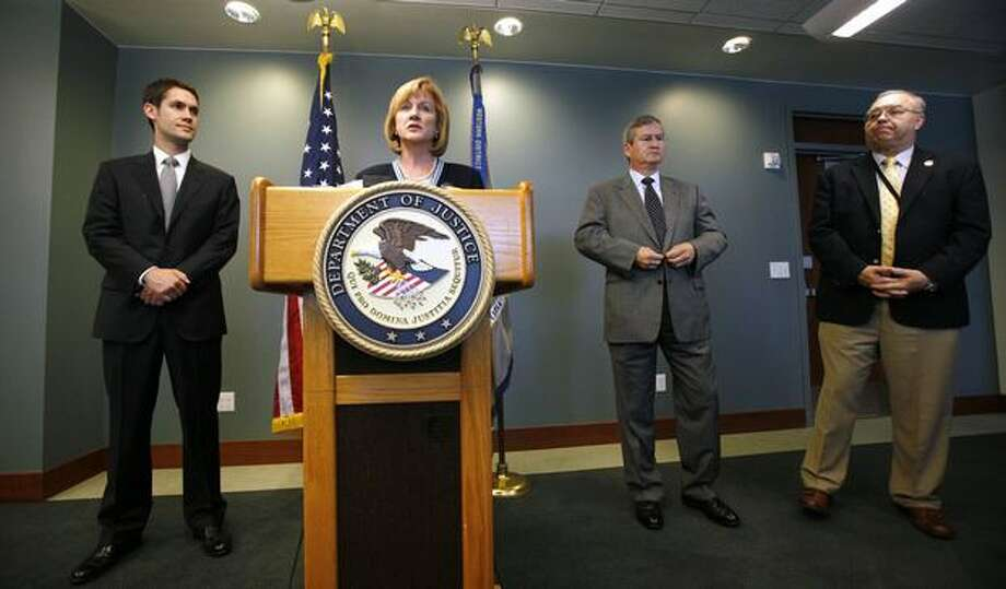 U.S. Attorney Jenny Durkan addresses a news conference as assistant U.S., Attorney Darwin Roberts, left, FBI special agent in-charge David Gomez and U.S. Marshal Joe Hawe look on at the U.S. Courthouse in Seattle. Colton Harris-Moore, the 19-year-old accused in a two-year string of thefts from Washington state to the Caribbean, did not seek bail in his first court appearance Thursday in Washington state and will remain jailed. Photo: Elaine Thompson, AP