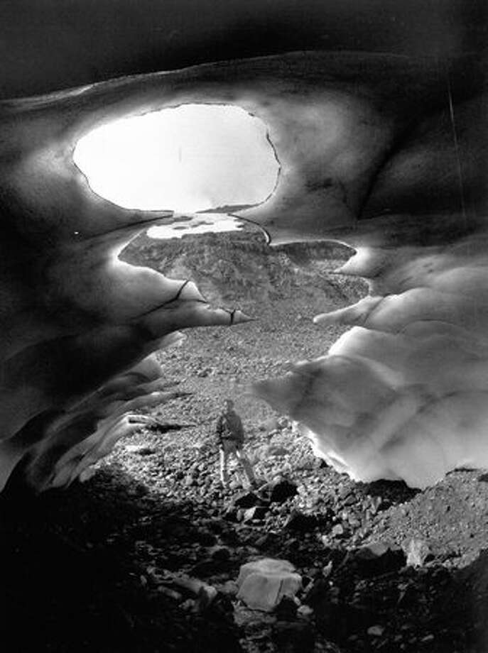1992: The wind and water action that once carved the Paradise ice caves still works on that remain in the Paradise basin.  (Cary Tolman). Photo: P-I File