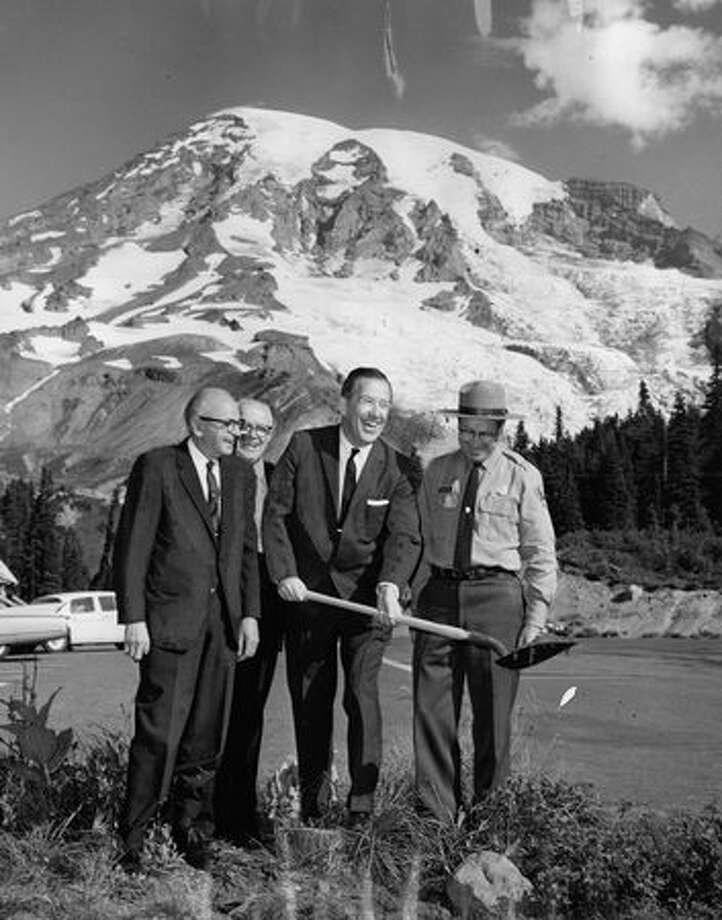 September 1963 - Harry Sprinker, chairman, Pierce County Commissioners; Paul Sceva, head of Mt. Rainier National Park Co.; Sen. Henry M. Jackson; John Rutter, Mt. Rainier National Park superintendent. Photo: P-I File