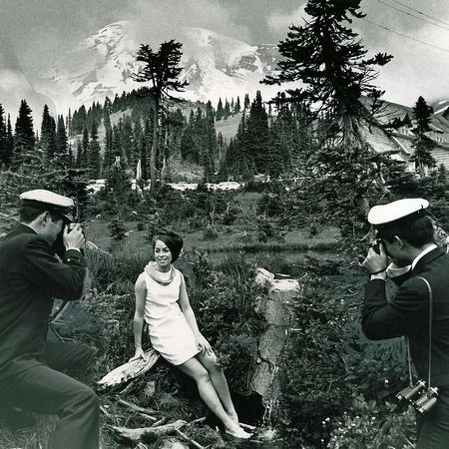Patty Wernick of Tacoma posed for a picture with Mount Rainier in 1968. (Tom Brownell) Photo: P-I File