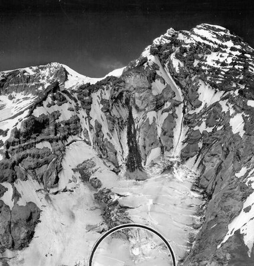 The southwest slopes of Mount Rainier and the southeast edge of South Tahoma glacier (circle) where a wreckage believed to be that of a missing marine transport plane was sighted in July 1947. When the plane disappeared in December 1946, all but the highest peaks were snow-covered. (Photo by U.S. Navy) Photo: P-I File