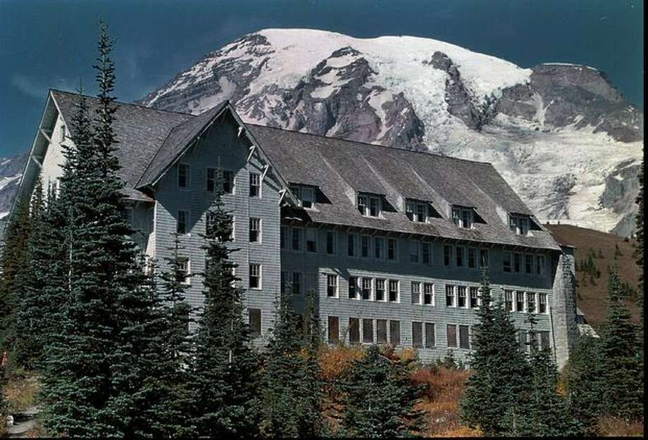 The Paradise Inn stands with Mount Rainier in the background in Mount Rainier National Park in Oct. 1, 1996. (AP Photo/Valley Daily News, by Gary Kissel/FILE) Photo: P-I File