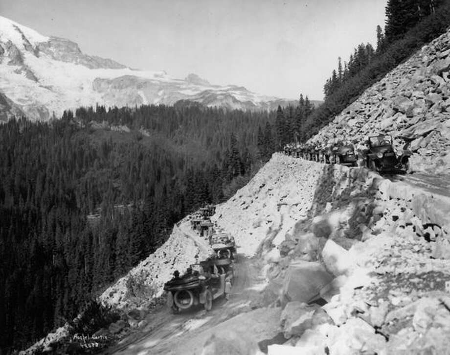 This photo shows cars winding their way along the narrow roads that brought visitors to Mount Rainier National Park in its early years. Date unknown. Photo: P-I File