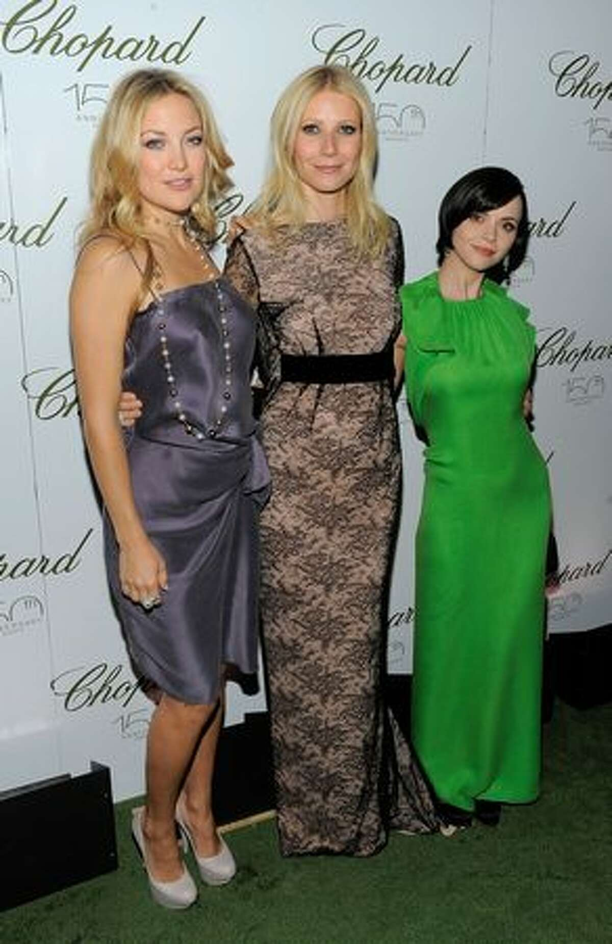 Actors Kate Hudson, Gwyneth Paltrow and Christina Ricci pose for a photo at the star studded gala celebrating Chopard's 150 years of excellence at The Frick Collection on April 29, 2010 in New York City.