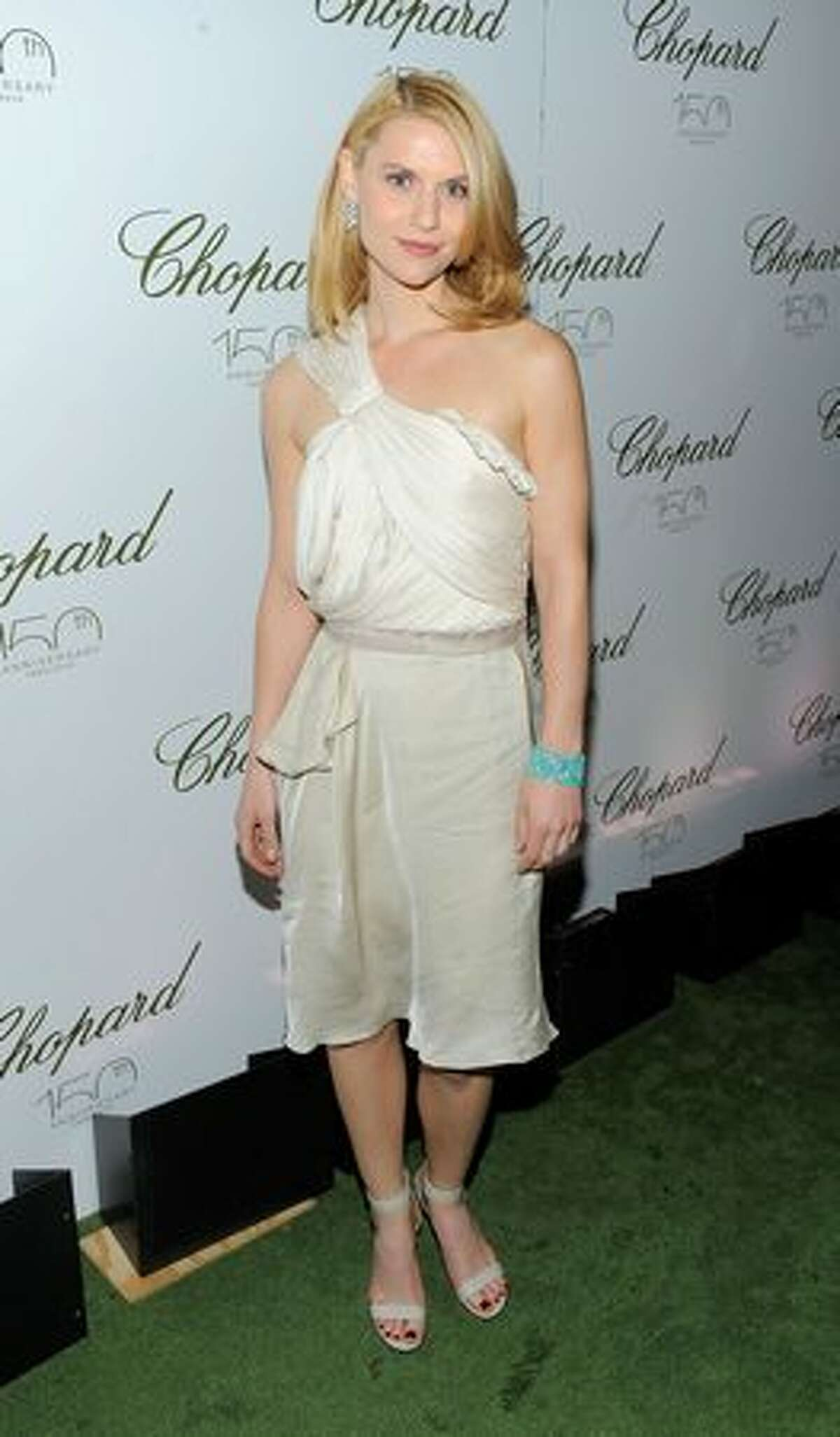 Actress Claire Danes poses for a photo at the star studded gala celebrating Chopard's 150 years of excellence at The Frick Collection on April 29, 2010 in New York City.