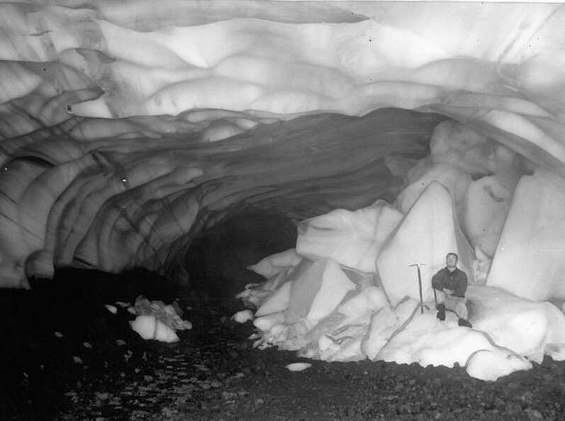 Jim Lyon deep in a Paradise cave on Mount Rainier, 1954.