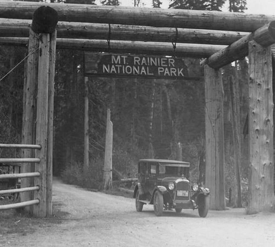 A 6-cylinder deluxe sedan at the entrance to Rainier National Park in May 1925. Photo: P-I File