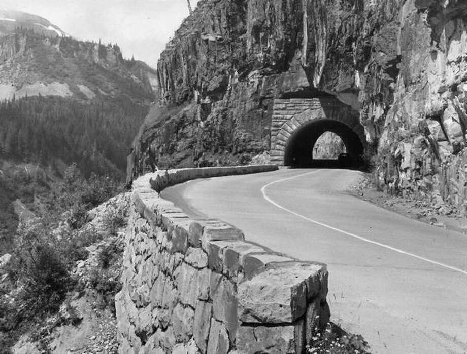 October 1965: This tunnel, high above a valley, is a scene on the Stevens Canyon Highway on the south slope of Mount Rainier. This highway, completed in 1957, makes possible an easy one-day drive around Mount Rainier. Photo: P-I File