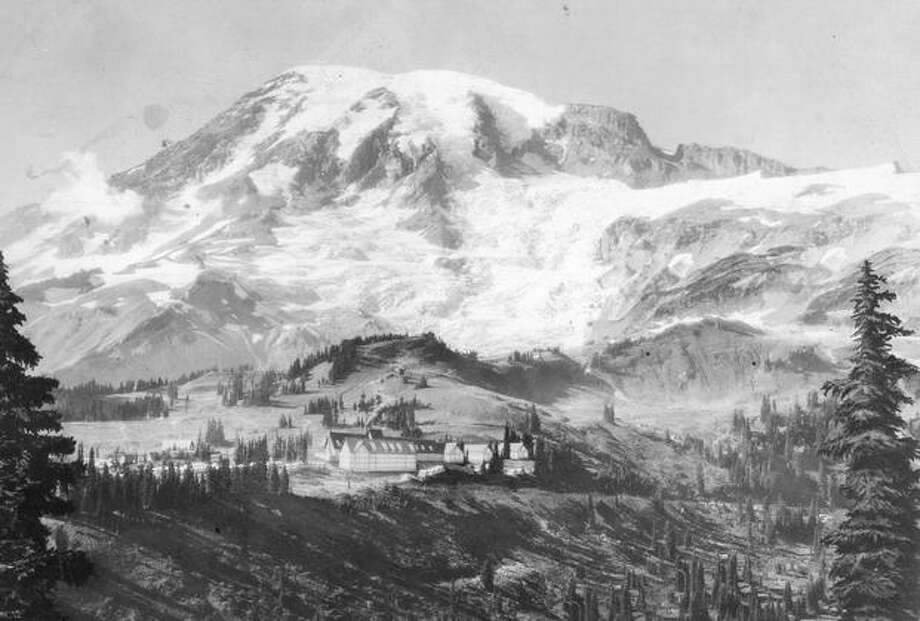 Paradise Valley, showing Paradise Inn and other structures in June 1930. The center building is the Guide service house; the building at the left is the service building for Paradise Camp. The southern exposure of the Mountain is shown, Nisqually Glacier in the foreground. (Photo by Rainier National Park Co.) Photo: P-I File