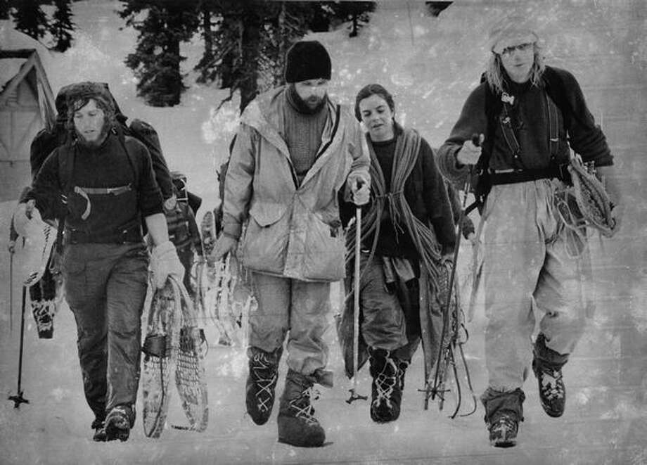 Avalanche survivors, led by Ian Yolles, left, arrive at Paradise Inn in March 1979. (Grant Haller/P-I) Photo: P-I File