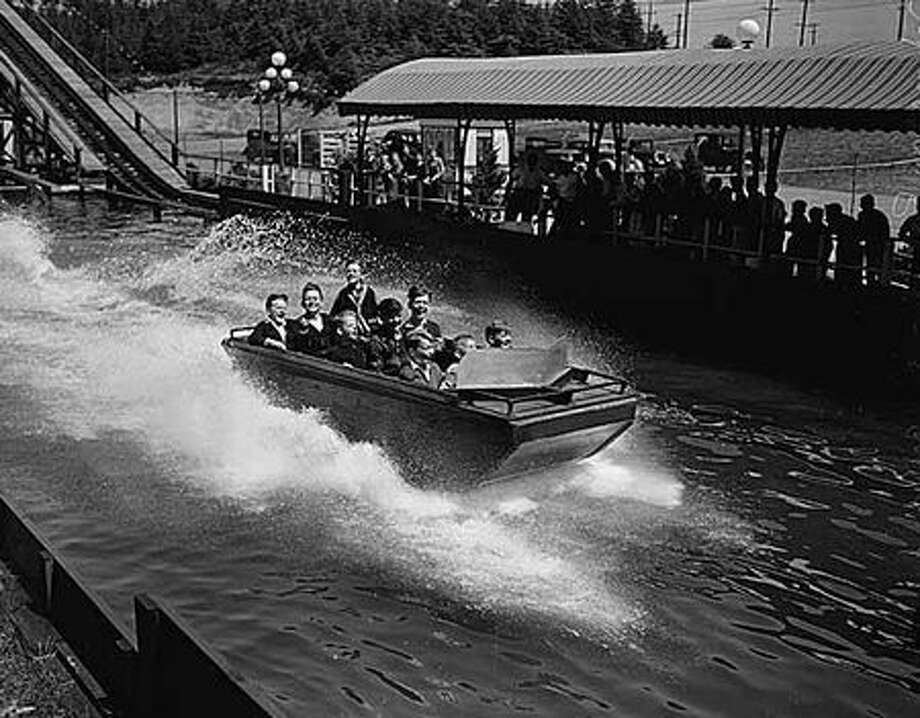 A Shoot-the-Chutes-style ride at Playland, 1940. (Seattlepi.com file/MOHAI collection) Photo: P-I File