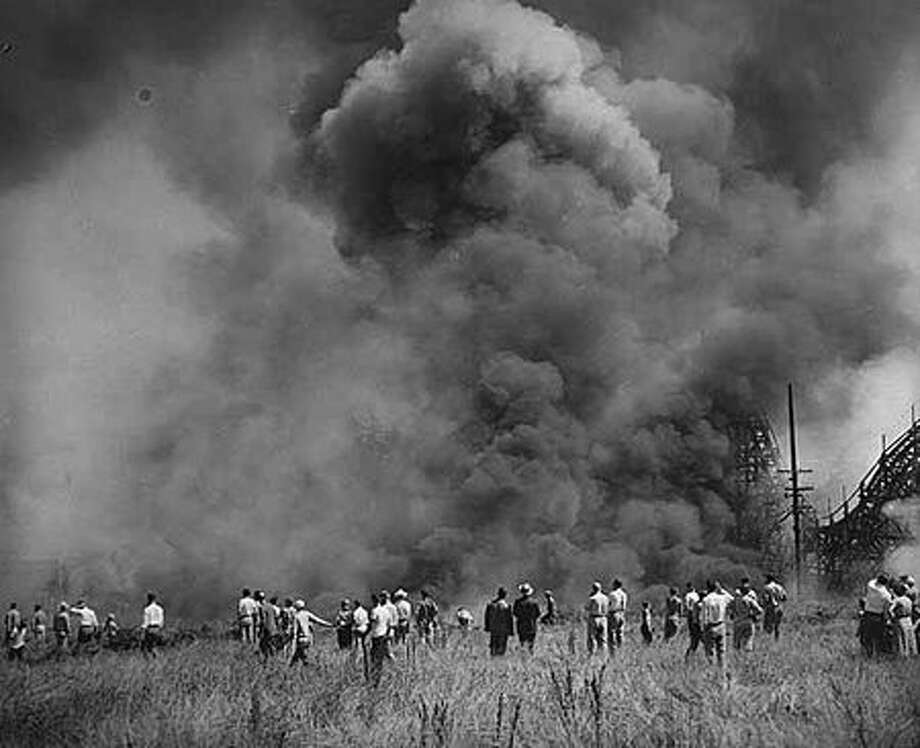 The August 1953 fire at Playland that started in the Old Mill, also called the Tunnel of Love. (Seattlepi.com file/MOHAI collection) Photo: P-I File