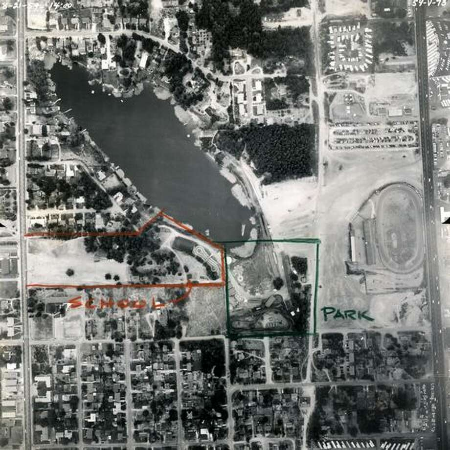 The site of Bitter Lake Playfield prior to purchase by Seattle Parks and Recreation, 1961. Playland had closed in 1960. The former speedway can also be seen where a Rite-Aid and other businesses now stand. Members of the Seattle School Board looked at the Playland site in 1956 as a possible location for a junior high school. The 43-room brick building was built on a 9.8-acre site and opened in September 1963 after being named the previous year for Reginald H. Thompson, who initiated the Denny Regrade. It closed in June 1981 and reopened the following September as Broadview-Thomson Elementary. Today Broadview-Thompson is a K-8 school. (Seattle Municipal Archives/28848) Photo: P-I File
