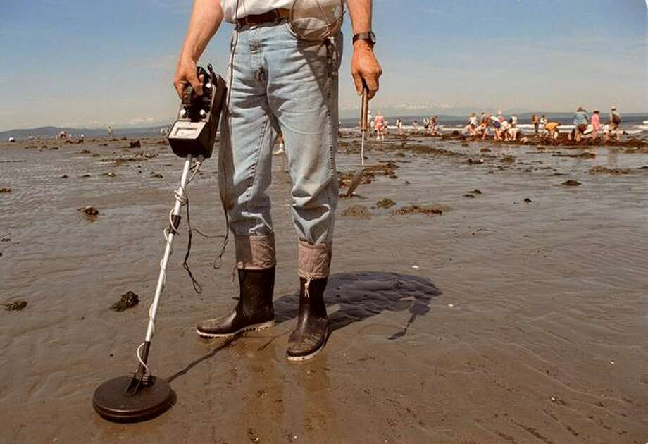 David Lofstrom looks for old stuff using a metal detector at former site of Luna Park, June 1999. Photo: P-I File