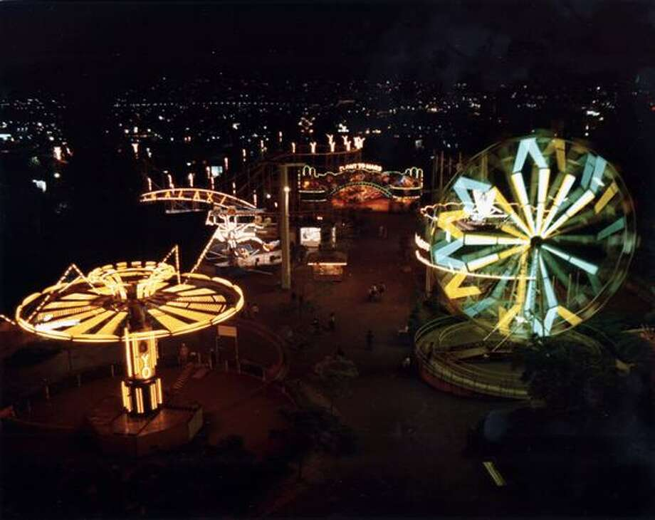 A night scene of the Fun Forest, circa 1970, showing the Yo-Yo, Galaxie roller coaster, the Flight to Mars and the Ferris wheel. (Seattle Municipal Archives/73169) Photo: P-I File