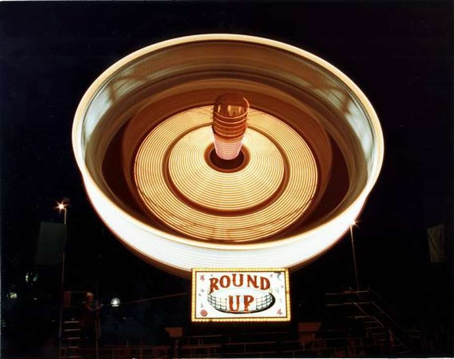A time-lapse photo of the Round Up ride at the Fun Forest, circa 1970. (Seattle Municipal Archives/73178) Photo: P-I File