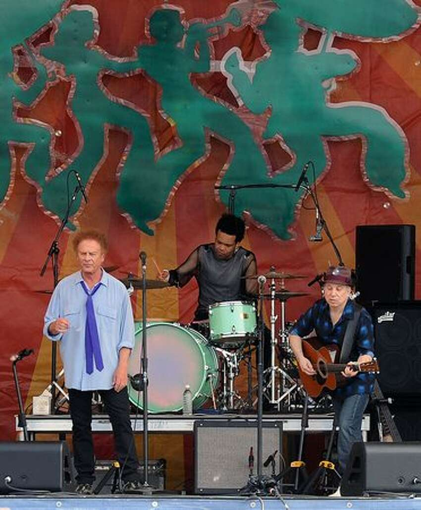 Simon & Garfunkel make their first-ever appearance at the New Orleans Jazz & Heritage Festival. Art Garfunkel (blue shirt) and Paul Simon (hat) perform at the 2010 New Orleans Jazz & Heritage Festival Presented By Shell at the Fair Grounds Race Course on April 24, 2010 in New Orleans.