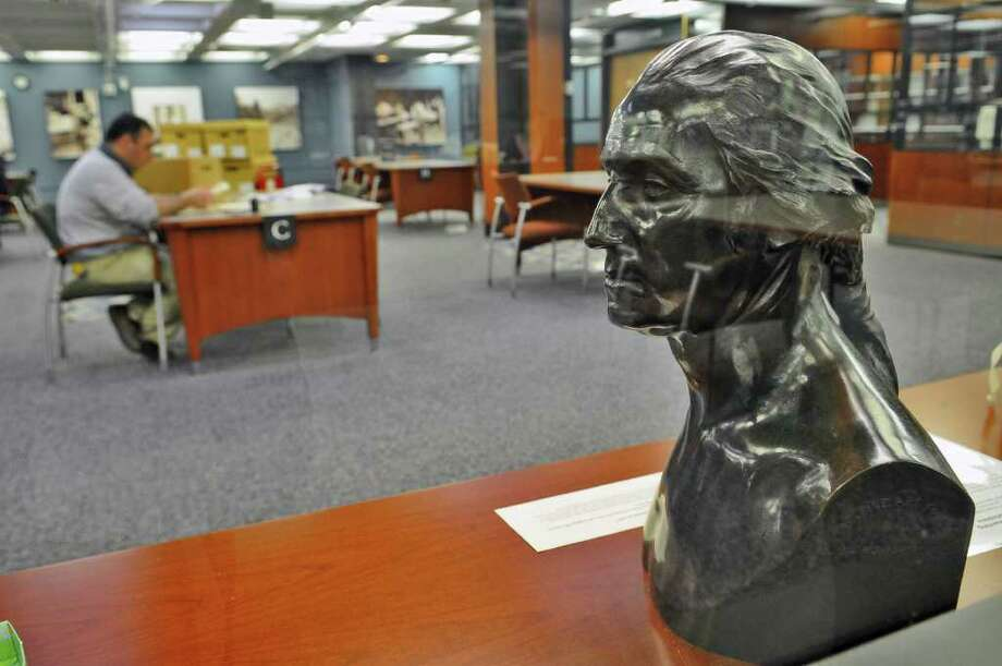 A bronze bust of George Washington from 1877 that had survived the Capitol fire of March 29, 1911, sits in the  New York State Library on Thursday March 10, 2011 in Albany, NY. The bust was returned to the library in 1921. It was also in  the office of Governor Franklin Delano Roosevelt afterwards. ( Philip Kamrass / Times Union ) Photo: Philip Kamrass