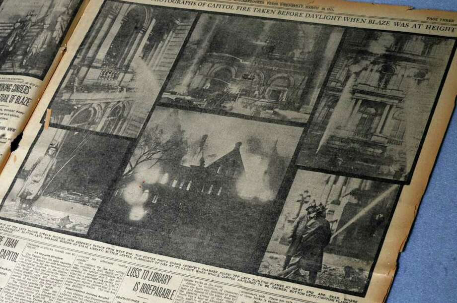 View of newspaper photographs from The Knickerbocker Press of the Capitol fire of March 29, 1911, on exhibit in the  New York State Library on Thursday March 10, 2011 in Albany, NY.  The newspaper is dated March 29, 1911. ( Philip Kamrass / Times Union ) Photo: Philip Kamrass