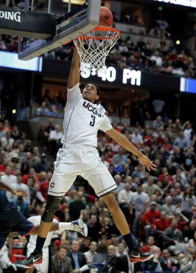 Connecticut's Jeremy Lamb goes up for a dunk during the second half of the NCAA West regional college basketball championship game, Saturday, March 26, 2011, in Anaheim, Calif.  (AP Photo/Jae C. Hong) Photo: AP