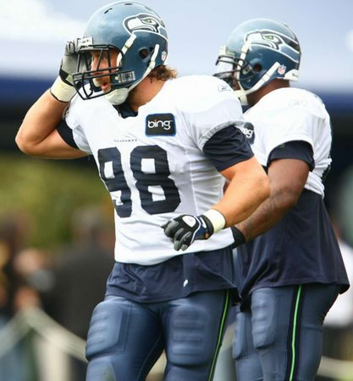 Seattle Seahawk Nick Reed practices with teammates during training camp.