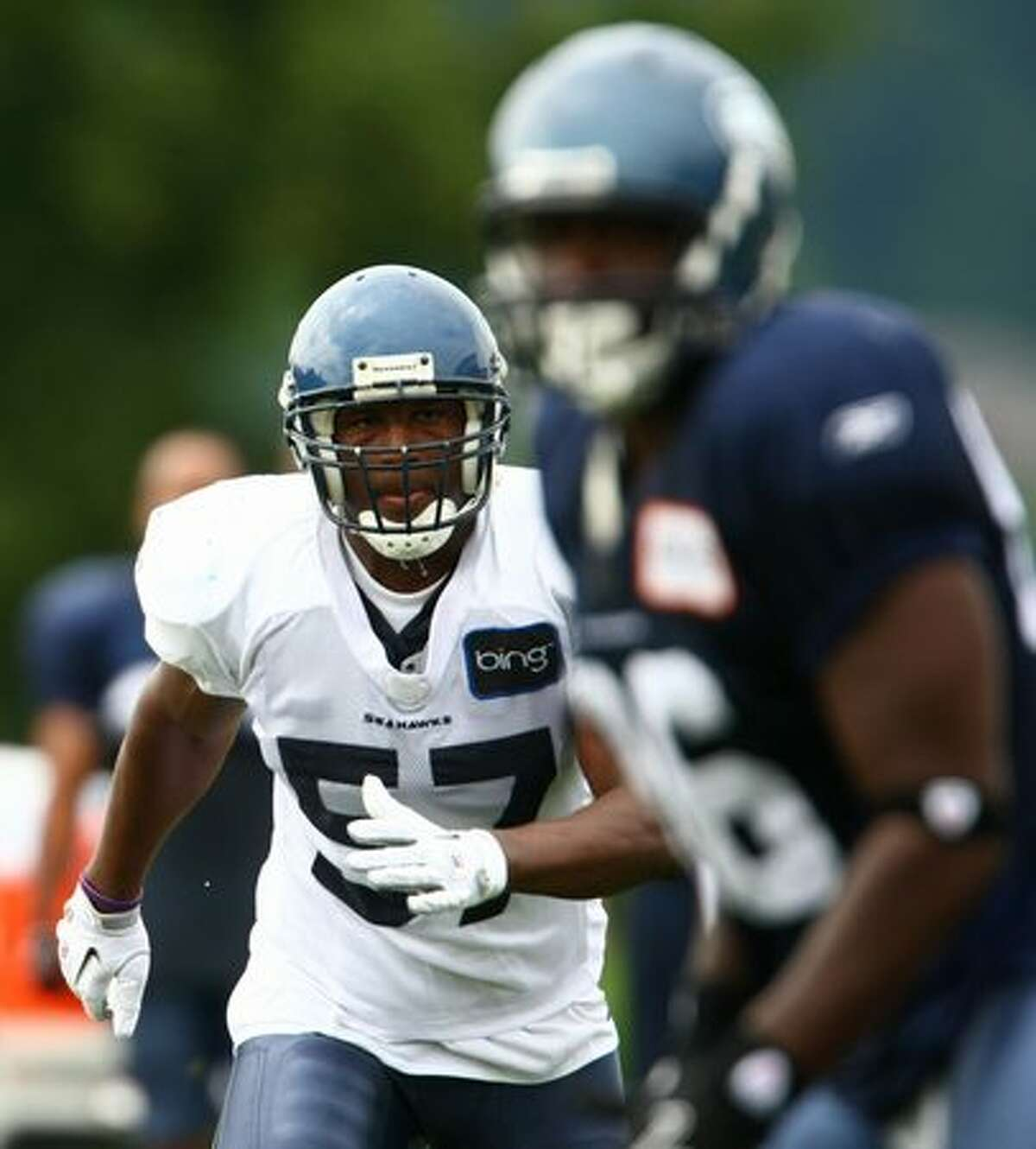Seattle Seahawk David Hawthorne (57) practices with teammates.