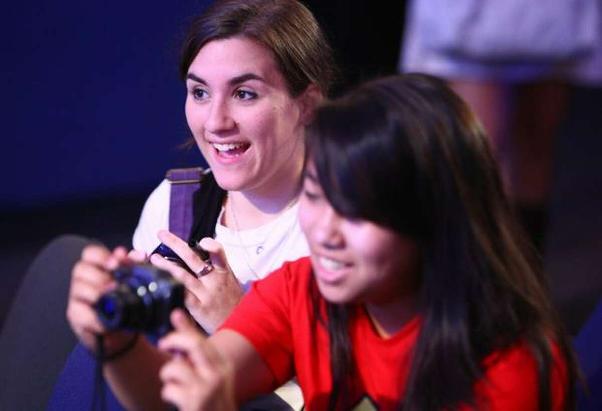 Mari Hamp, 18, left, and Kristen Numata, 18, try to get photos of actor Matthew Lewis, who plays the character Neville Longbottom in the Harry Potter films, during a publicity event at the Pacific Science Center.