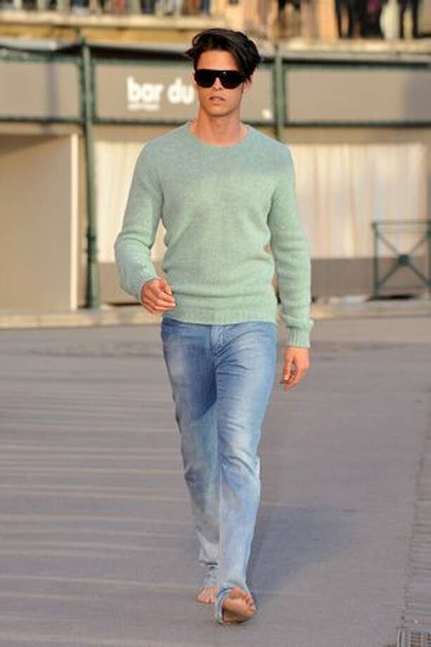 Model Baptiste Giabiconi walks the runway during the Chanel Cruise Collection Presentation on Tuesday, May 11 in Saint-Tropez, France. Photo: Getty Images