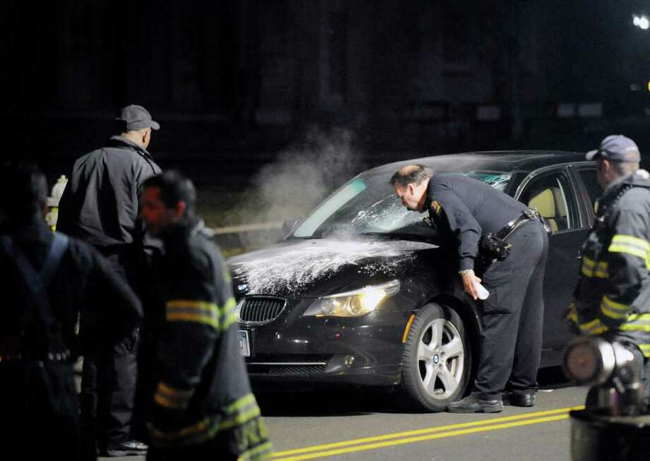 Police investigate the scene of an accident on East Putnam Avenue near Christ Chruch Greenwich, in which a bus driver was struck by a car, Tuesday night, March 1, 2011. Photo: File Photo / Greenwich Time File Photo