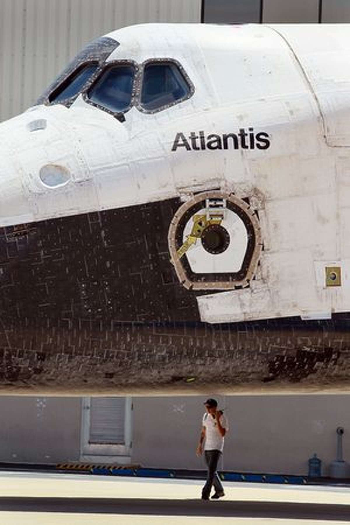 The Space Shuttle Atlantis is seen parked in front of the Orbiter Processing Facility after it returned to Kennedy Space Center in Cape Canaveral, Florida.