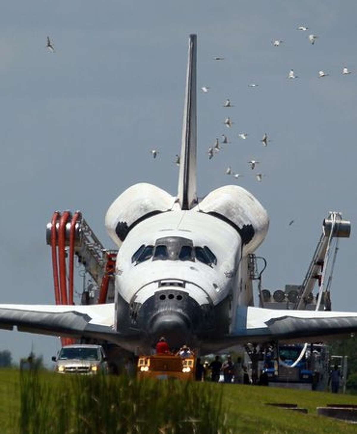 The Space Shuttle Atlantis is towed back to the Orbiter Processing Facility after it returned to Kennedy Space Center in Cape Canaveral, Florida.