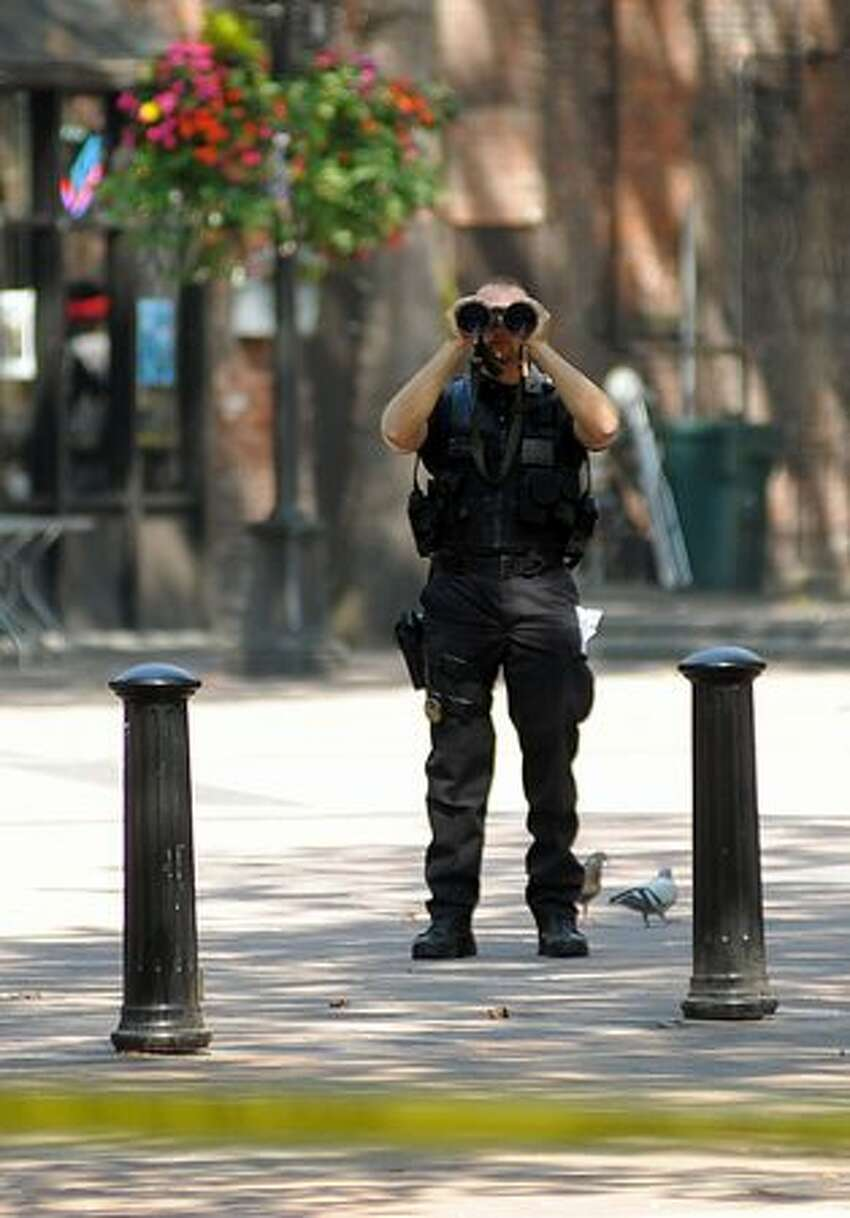 A Seattle Police officer scopes out the scene in Pioneer Square awaiting President Barack Obama's visit to the Grand Central Bakery in Pioneer Square Tuesday.