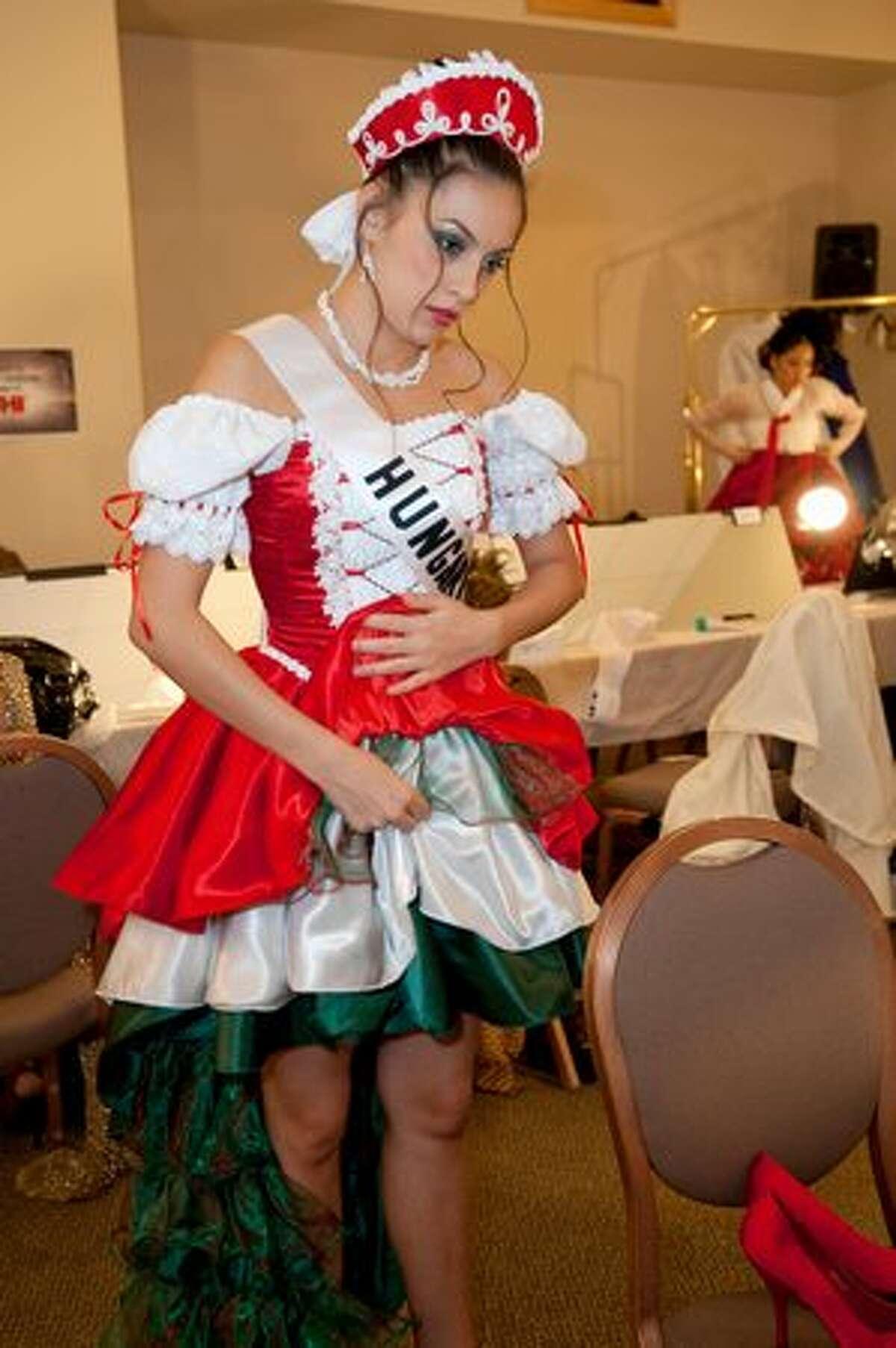 Timea Babinyecz, Miss Hungary 2010, prepares herself backstage.