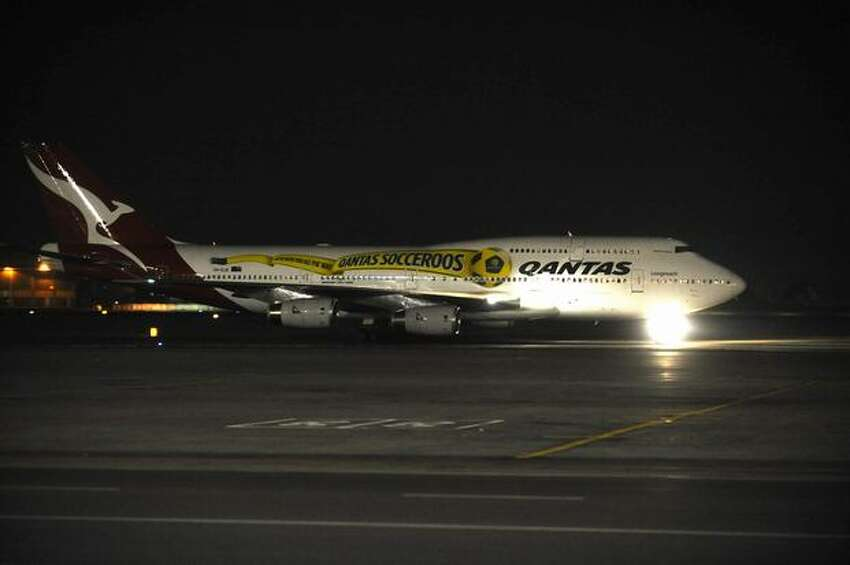 A plane carrying players of the Australian National Football (soccer) team lands at the O.R. Tambo airport in Johannesburg, South Africa, making Australia became the first country to arrive in South Africa for the 2010 World Cup