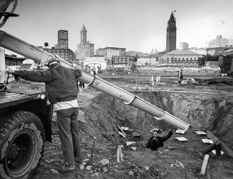 The November 1972 photo caption read: Workmen poured concrete Friday that will form the pilings on which the foundation of the new King County domed stadium will rest. Photo: P-I File