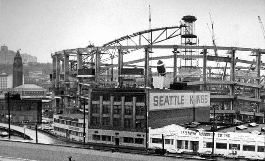 The May 1974 photo caption read: The Seattle Kings have been ordered to remove the giant football sign poised for a kickoff above its headquarters at 901 Occidental Ave. S. Photo: P-I File