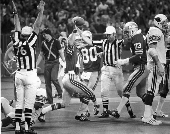 Seattle Seahawks Quarterback, Jim Zorn, holds the football after dashing 8 yards to score the Seahawks' final touchdown in their 30-24 loss to St. Louis Cardinals in the Kingdome, Sept 12, 1976 Photo: P-I File