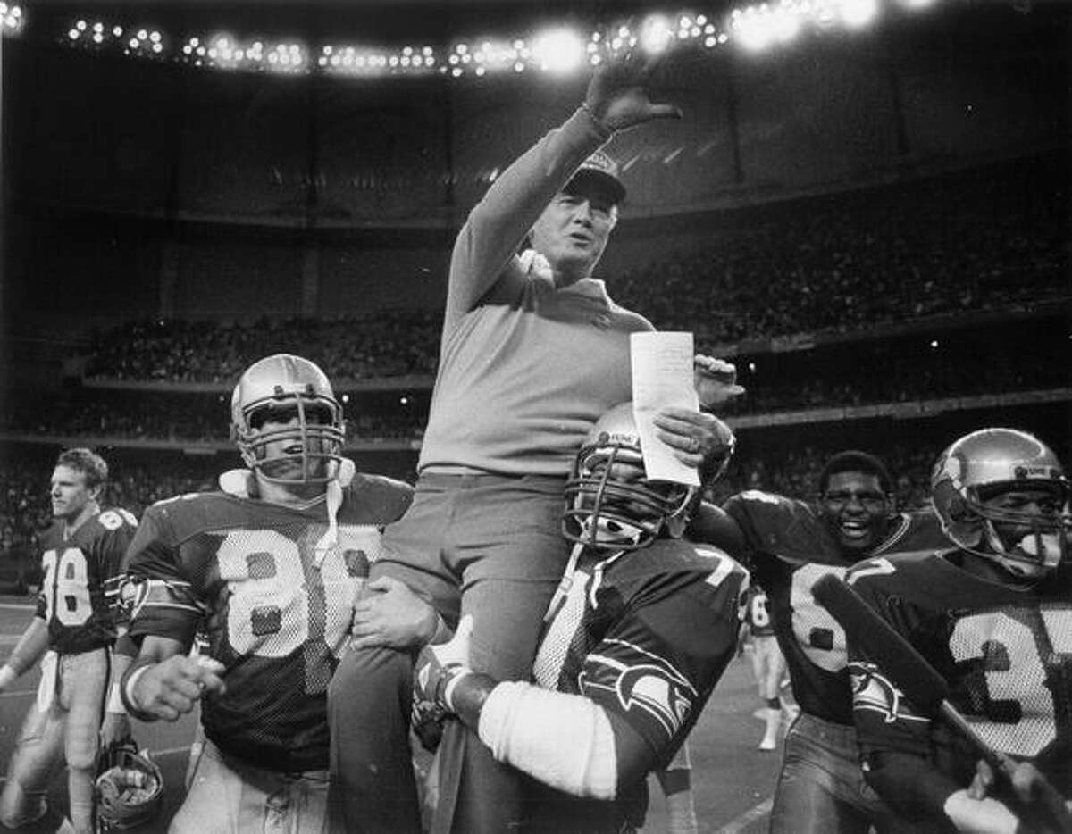 Chuck Knox is carried off the Kingdome field after a win that sent the Seahawks to the 1983 playoffs.