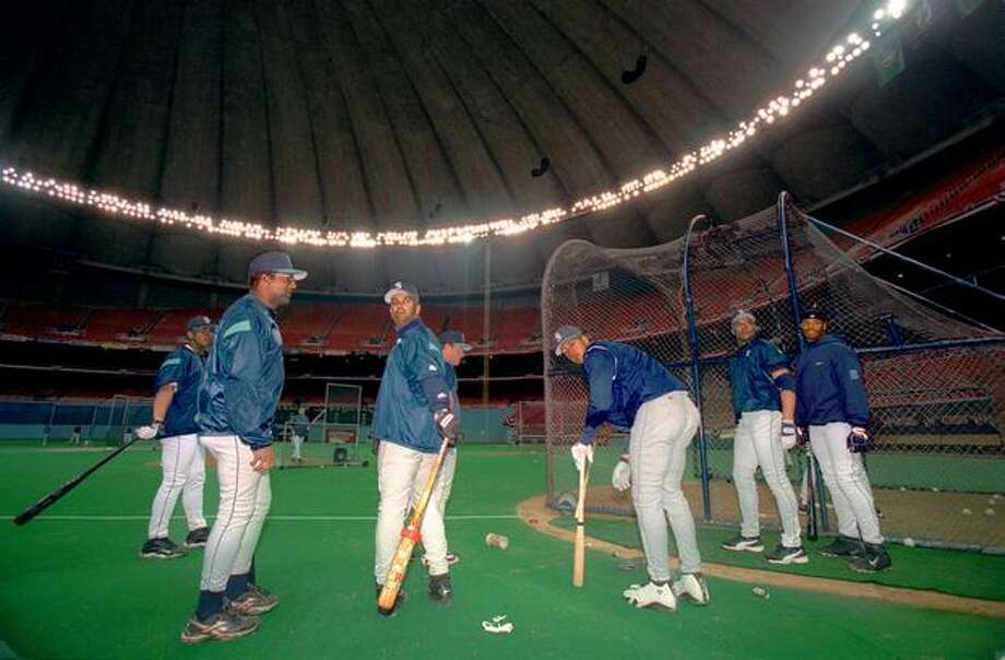 Mariners players wait their turn at the batting cage durring the first practice in the Kingdome, 1999. Photo: P-I File