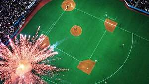 This photo, shot from the roof of the Kingdome, shows a firework exploding as Seattle Mariners David Segui rounds 2nd base. Segui had a sixth inning home run against the Texas Rangers, June 25, 1999.