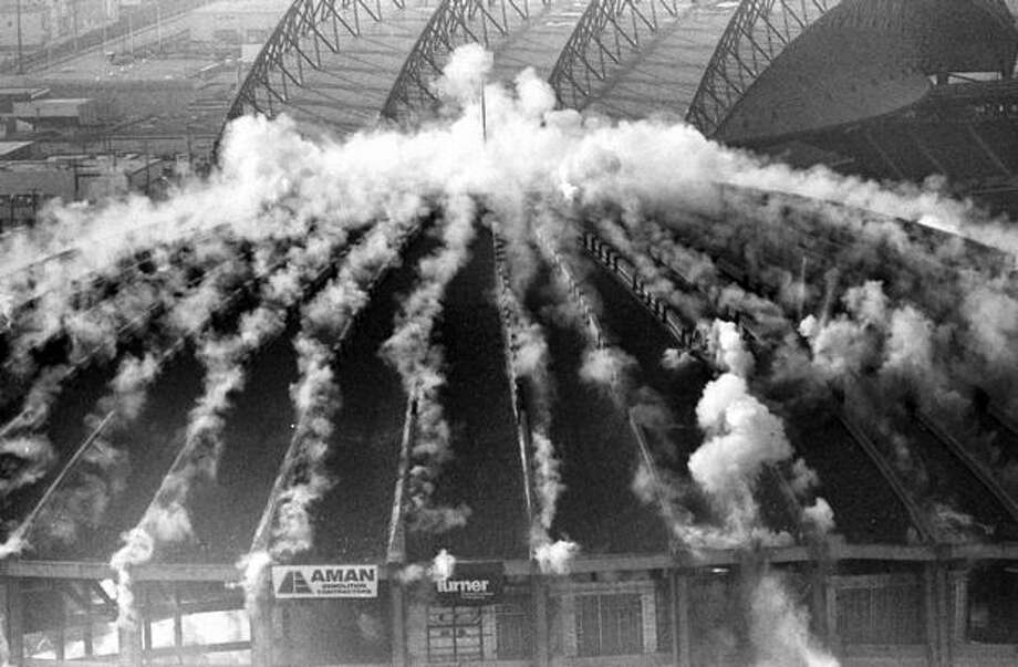 The second in a series of four photos of the Kingdome implosion, March 26, 2000 (Phil H. Webber/Seattlepi.com file) Photo: P-I File