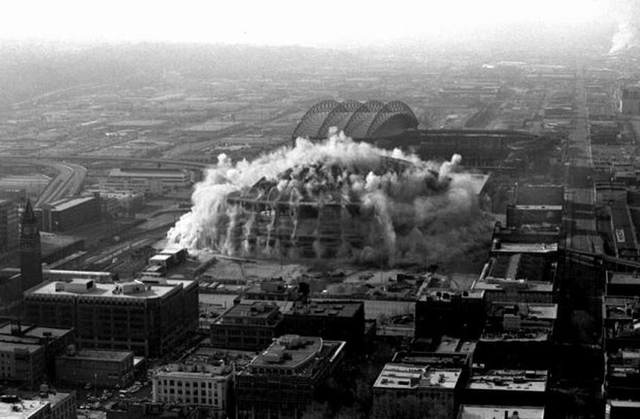 The third in a series of four photos of the Kingdome implosion, March 26, 2000 (Phil H. Webber/Seattlepi.com file) Photo: P-I File
