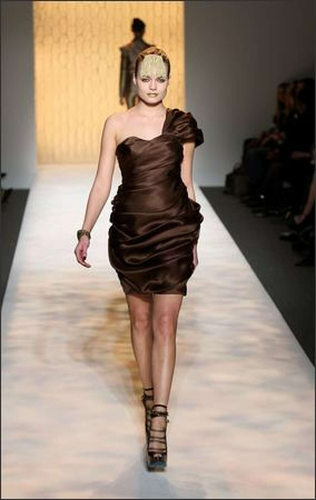 A model walks the runway during the Christian Siriano Fall 2009 fashion show at Mercedes-Benz Fashion Week in New York, Thursday, Feb. 19, 2009.
