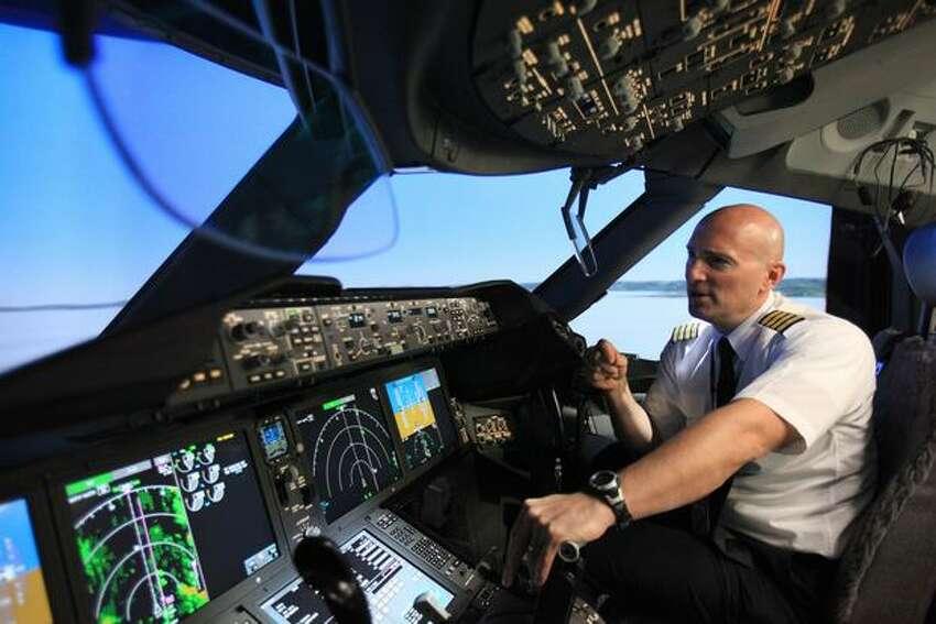 Boeing pilot instructor Gregg Pointon shows off a 787 Dreamliner full-flight simulator at Boeing's training center in Renton, Wash.