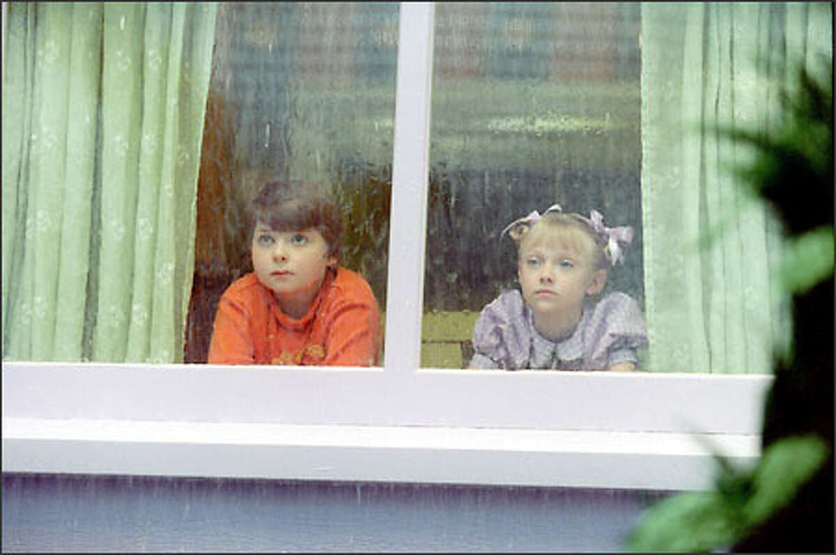 """""""Too wet to go out and too cold to play ball ..."""" Conrad (Spencer Breslin) and Sally (Dakota Fanning) were sitting in the house and doing nothing at all."""