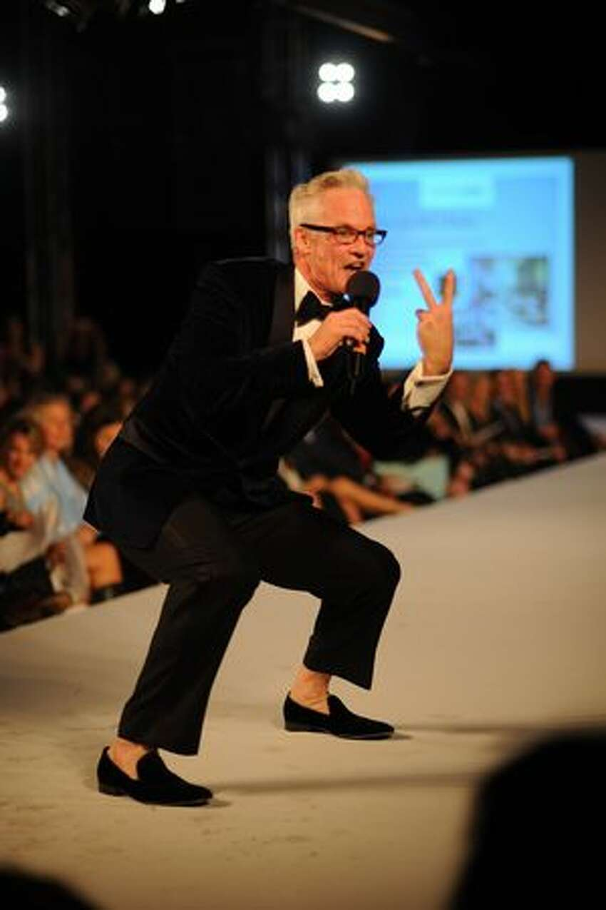 John Curley gives an energetic, if not athletic, performance as he auctions off items at the 7th Annual Fashion First show. Auction items were sold to raise money for Rise N Shine.