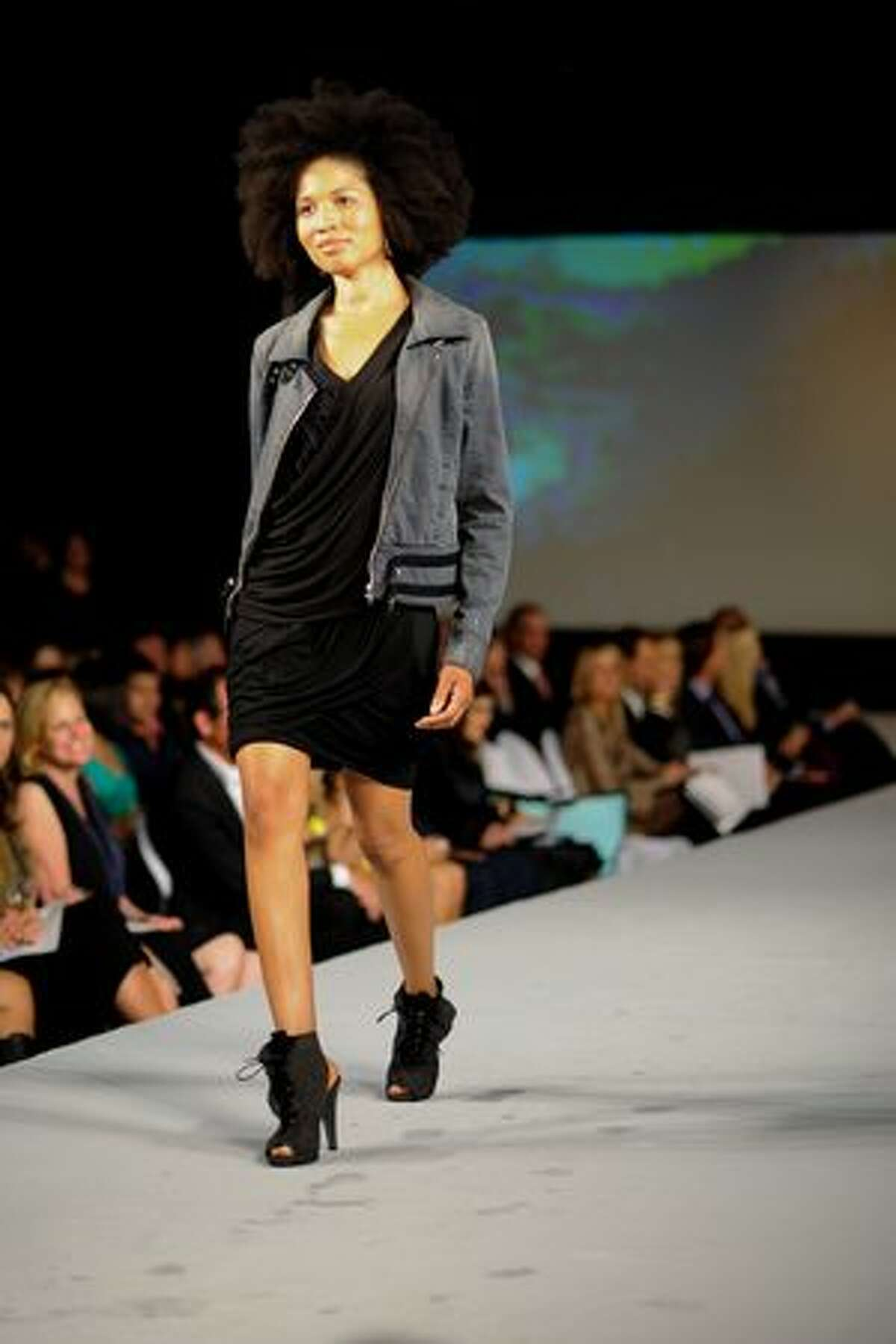 Models walk the runway showing off the latest styles from La Ree Boutique.