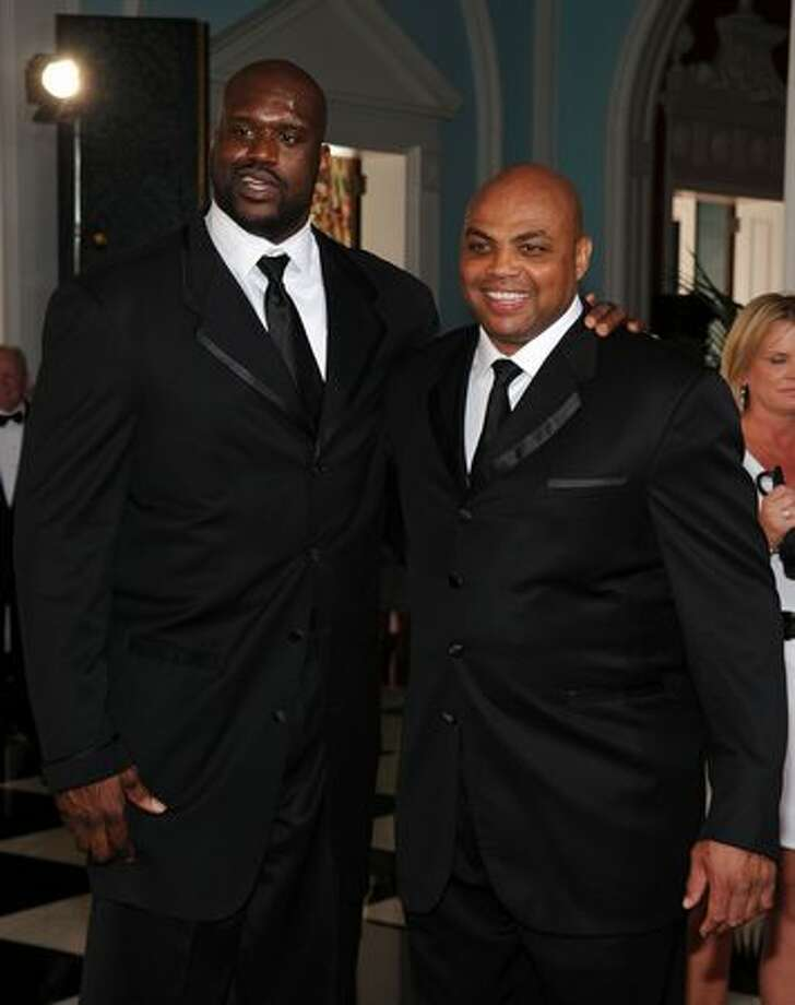 Basketball players Shaquille O'Neal and Charles Barkley attend the grand opening. Photo: Getty Images