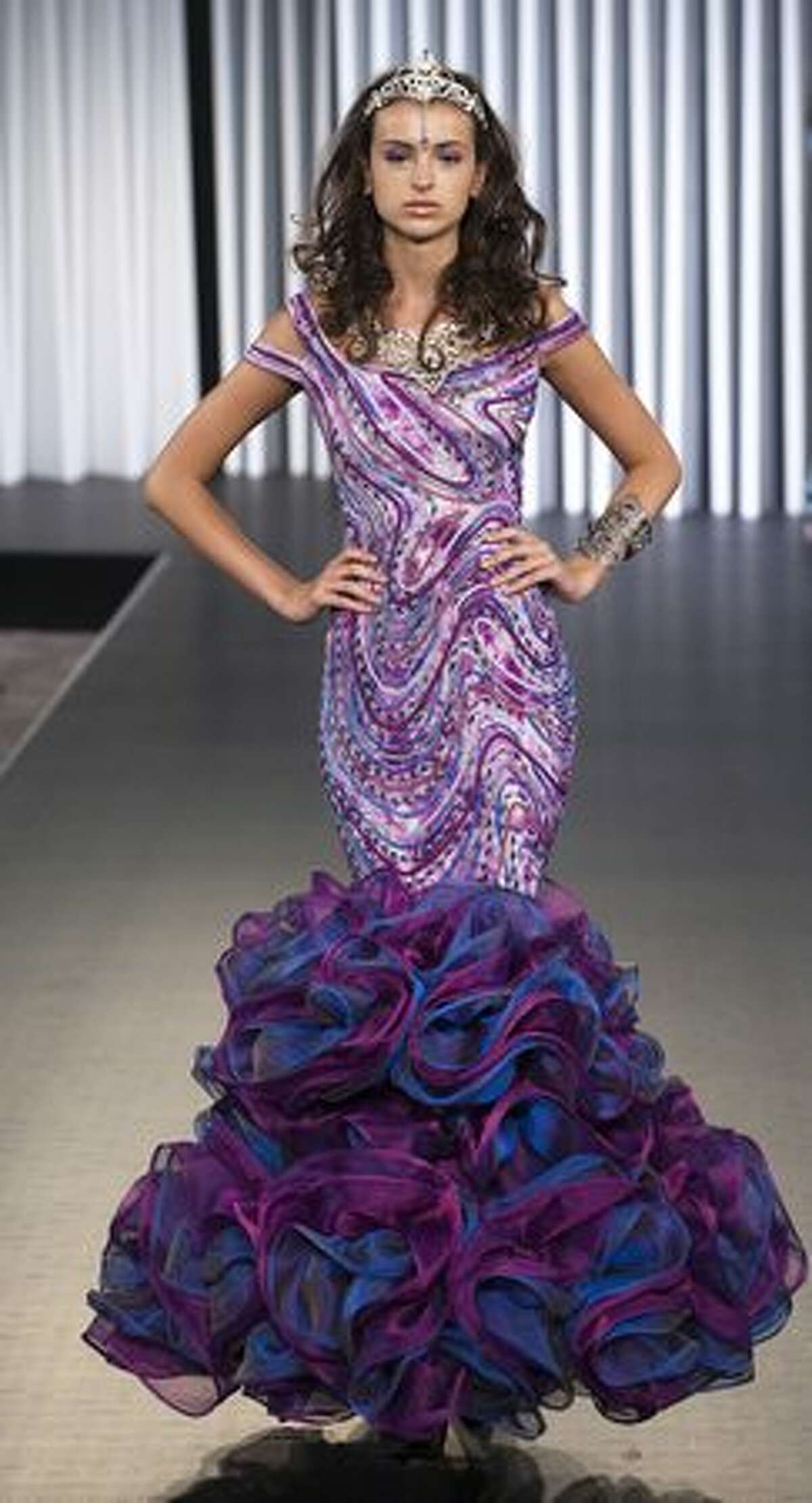 A model displays a creation by Ika Butoni on the catwalk during the