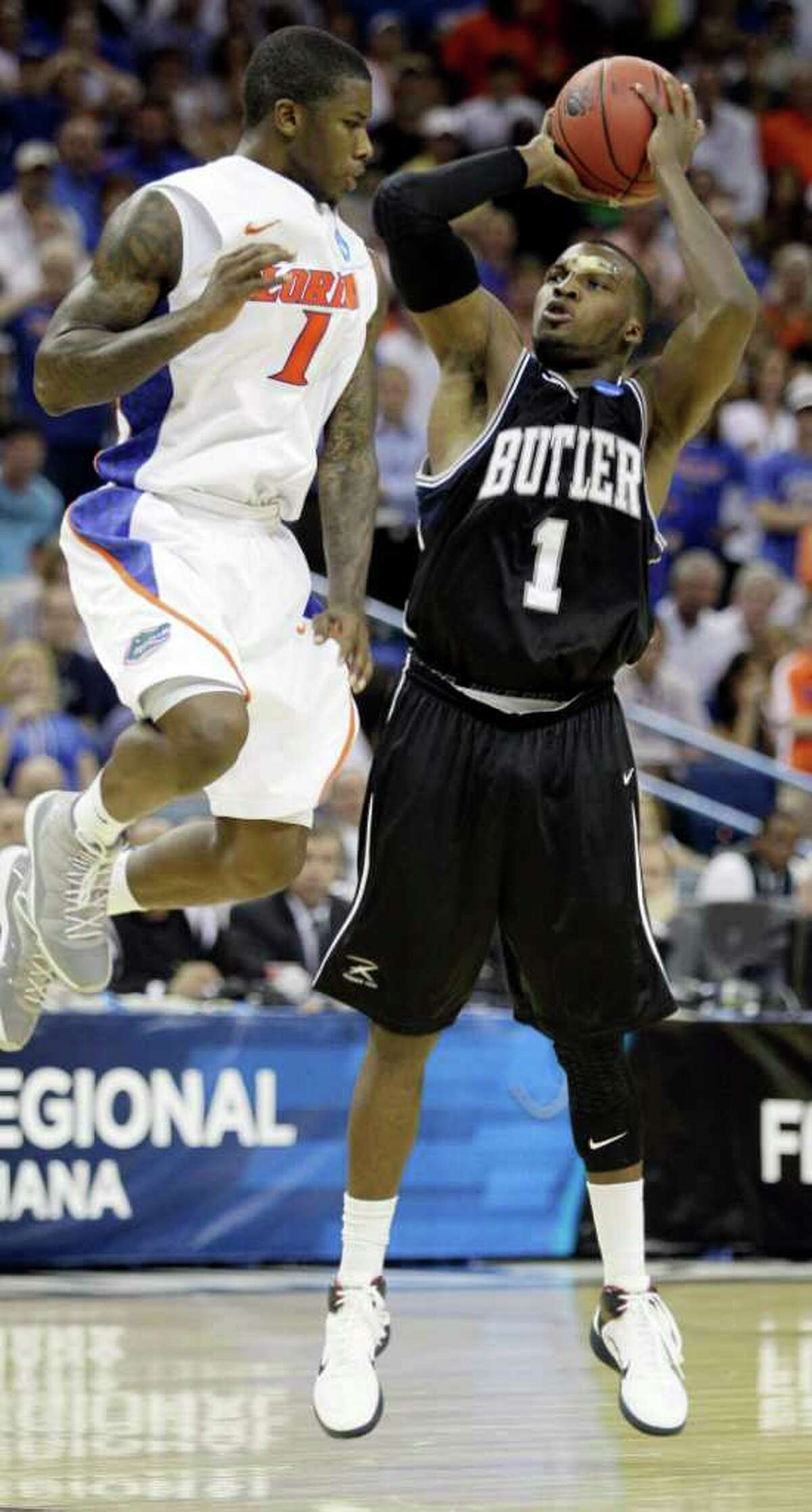 Butler's Shelvin Mack shoots with Florida's Kenny Boynton defending during overtime of the NCAA Southeast regional college basketball championship game Saturday, March 26, 2011, in New Orleans. (AP Photo/Patrick Semansky)